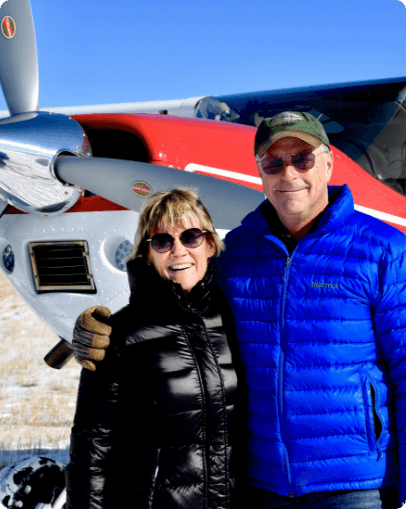 John McKenna and his wife pose by their airplane