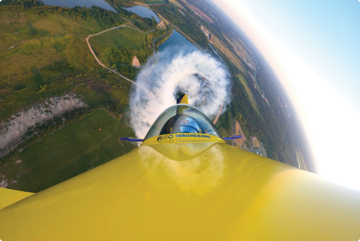View of Kevin Coleman in cabin of aerobatic plane