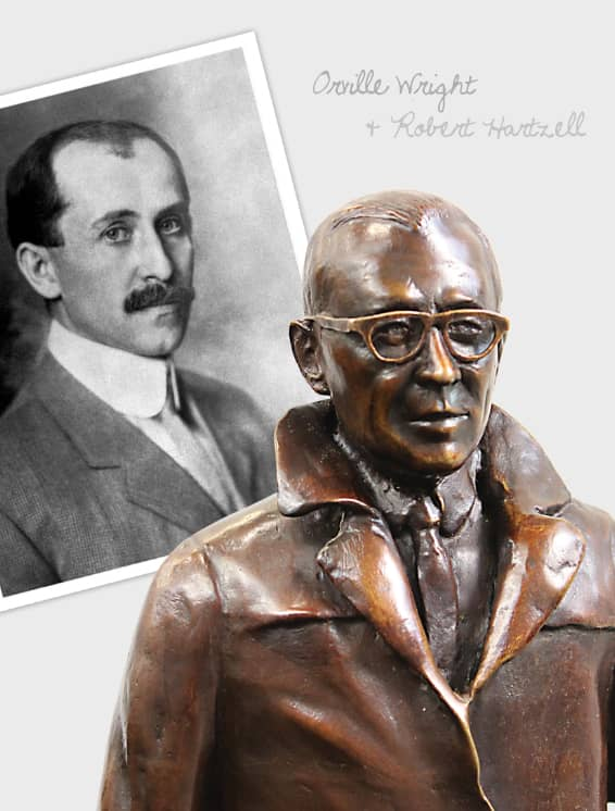 Photo of Orville Wright next to statue of Robert Hartzell